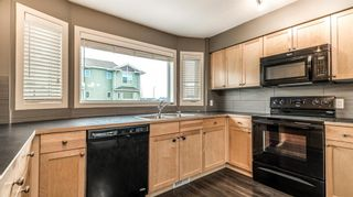 Photo 9: 322 STRATHCONA Circle: Strathmore Row/Townhouse for sale : MLS®# A1062411