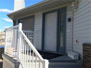 Photo 3: 12 WEST COPITHORNE Place: Cochrane House for sale : MLS®# C4049219
