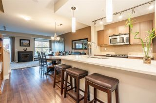 "Photo 2: 205 2110 ROWLAND Street in Port Coquitlam: Central Pt Coquitlam Townhouse for sale in ""AVIVA ON THE PARK"" : MLS®# R2521189"