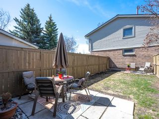 Photo 13: 55 123 Queensland Drive SE in Calgary: Queensland Row/Townhouse for sale : MLS®# A1101736