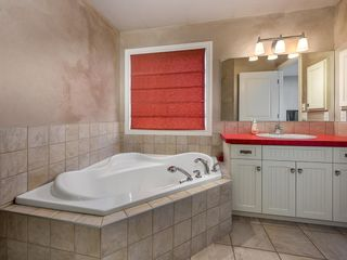 Photo 17: 27 Cougar Plateau Way SW in Calgary: Cougar Ridge Detached for sale : MLS®# A1113604