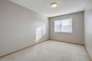 Photo 24: 105 Rocky Ridge Court NW in Calgary: Rocky Ridge Row/Townhouse for sale : MLS®# A1069587