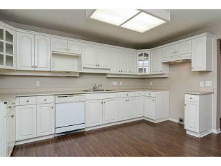 "Photo 3: 101 17730 58A Avenue in Surrey: Cloverdale BC Condo for sale in ""Derby Downs"" (Cloverdale)  : MLS®# F1450852"