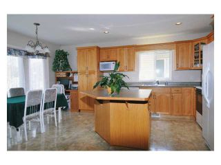 """Photo 3: 23943 115TH Avenue in Maple Ridge: Cottonwood MR House for sale in """"TWIN BROOKS"""" : MLS®# V822106"""