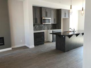 Photo 14: 23 Sunrise Heights: Cochrane Duplex for sale : MLS®# A1017998