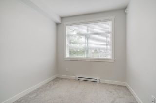 """Photo 13: 418 20696 EASTLEIGH Crescent in Langley: Langley City Condo for sale in """"The Georgia"""" : MLS®# R2574305"""