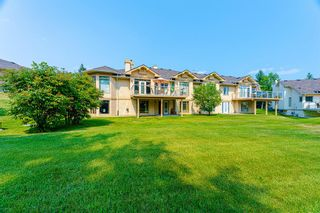Photo 2: 126 Country Club Lane in Rural Rocky View County: Rural Rocky View MD Semi Detached for sale : MLS®# A1129942
