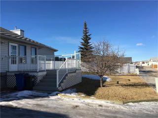 Photo 45: 12 WEST COPITHORNE Place: Cochrane House for sale : MLS®# C4049219