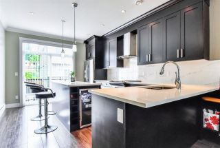 """Photo 1: 122 13670 62 Avenue in Surrey: Sullivan Station Townhouse for sale in """"Panorama 62"""" : MLS®# R2577644"""