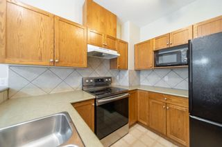 Photo 9: 404 720 Willowbrook Road NW: Airdrie Row/Townhouse for sale : MLS®# A1098346