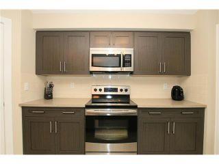 Photo 12: 7 FIRESIDE Parkway: Cochrane House for sale : MLS®# C4068645