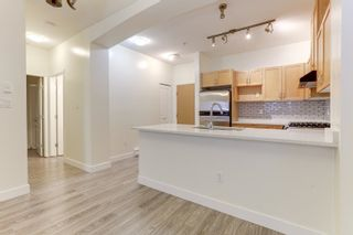 """Photo 12: 108 2951 SILVER SPRINGS Boulevard in Coquitlam: Westwood Plateau Condo for sale in """"TANTULUS"""" : MLS®# R2601029"""
