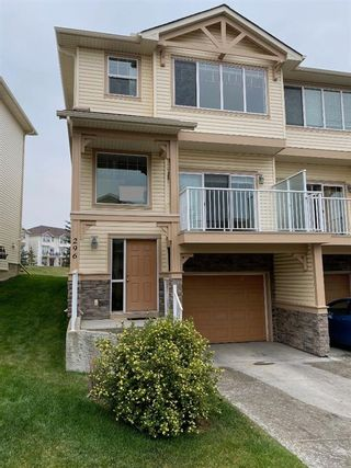Photo 1: 296 Sunset Point: Cochrane Row/Townhouse for sale : MLS®# A1134676