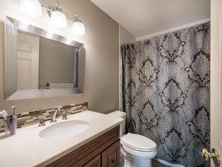 Photo 17: 208 WEST TERRACE Place: Cochrane House for sale : MLS®# C4192643