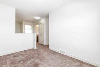 Photo 17: 268 Rainbow Falls Drive: Chestermere Row/Townhouse for sale : MLS®# A1118843