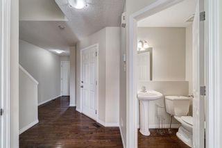 Photo 4: 4 136 Bow Ridge Drive: Cochrane Row/Townhouse for sale : MLS®# A1116097