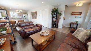 """Photo 4: 8320 88 Street in Fort St. John: Fort St. John - City SE 1/2 Duplex for sale in """"MATTHEWS PARK"""" (Fort St. John (Zone 60))  : MLS®# R2602097"""