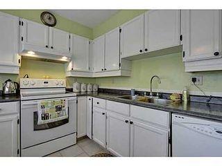 Photo 8: 22 COACHWAY Green SW in Calgary: 4 Level Split for sale : MLS®# C3572923
