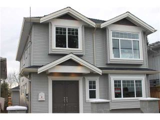 Photo 2: 7657 DAVIES Street in Burnaby: Edmonds BE House for sale (Burnaby East)  : MLS®# V928171