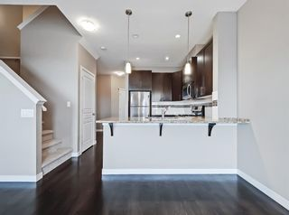 Photo 3: 2004 881 Sage Valley Boulevard NW in Calgary: Sage Hill Row/Townhouse for sale : MLS®# A1085276