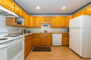 "Photo 2: 115 2451 GLADWIN Road in Abbotsford: Central Abbotsford Condo for sale in ""CENTENNIAL COURT"" : MLS®# R2530103"