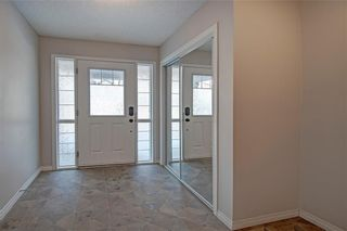 Photo 4: 169 WINDSTONE Avenue SW: Airdrie Row/Townhouse for sale : MLS®# A1064372