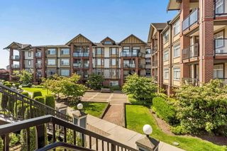 "Photo 11: 375 20170 FRASER Highway in Langley: Langley City Condo for sale in ""PADDINGTON STATION"" : MLS®# R2436069"