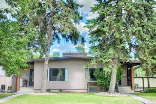 Photo 1: 702/704 53 Avenue SW in Calgary: Windsor Park Duplex for sale : MLS®# A1122930