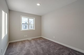 Photo 25: 309 81 Greenbriar Place NW in Calgary: Greenwood/Greenbriar Row/Townhouse for sale : MLS®# A1058995