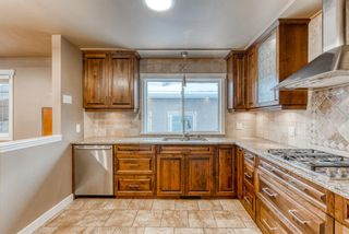 Photo 7: 220 78 Avenue SE in Calgary: Fairview Detached for sale : MLS®# A1063435