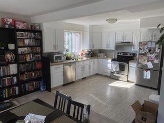Photo 3: 801 68 Avenue SW in Calgary: Kingsland Semi Detached for sale : MLS®# A1084649