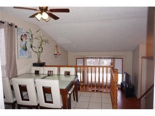 Photo 7: 260 ERIN MEADOW Close SE in Calgary: Erin Woods House for sale : MLS®# C4095343