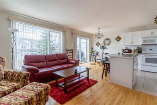 Photo 8: 112 Rocky Vista Circle NW in Calgary: Rocky Ridge Row/Townhouse for sale : MLS®# A1125808