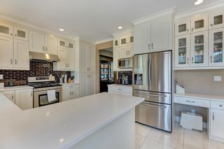 """Photo 15: 7439 146 Street in Surrey: East Newton House for sale in """"Chimney Heights"""" : MLS®# R2602834"""