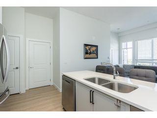"Photo 3: 405 8488 160 Street in Surrey: Fleetwood Tynehead Condo for sale in ""Oasis"" : MLS®# R2623411"