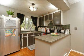 Photo 7: 56 7205 4 Street NE in Calgary: Huntington Hills Row/Townhouse for sale : MLS®# A1021724