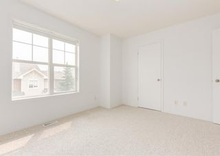 Photo 29: 311 Toscana Gardens NW in Calgary: Tuscany Row/Townhouse for sale : MLS®# A1133126