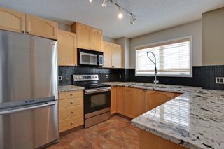 Photo 6: 3103 7171 Coach Hill Road SW in Quinterra: Townhouse for sale : MLS®# C3635341