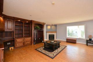 Photo 36: 303 GLENEAGLES View: Cochrane House for sale : MLS®# C4130061