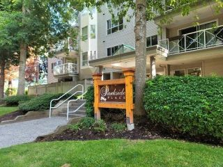 """Photo 1: 106 20088 55A Avenue in Langley: Langley City Condo for sale in """"Parkside Place"""" : MLS®# R2605454"""