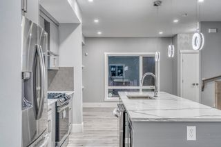 Photo 7: 4302 Bowness Road NW in Calgary: Montgomery Row/Townhouse for sale : MLS®# A1148589