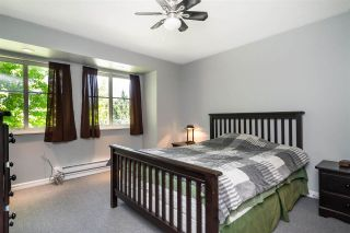 """Photo 17: 217 19953 55A Avenue in Langley: Langley City Condo for sale in """"Bayside Court"""" : MLS®# R2589418"""