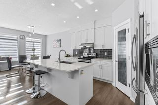 Photo 5: 162 Howse Rise NE in Calgary: Livingston Detached for sale : MLS®# A1153678