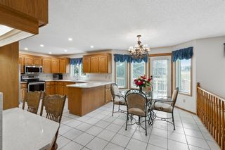 Photo 8: 927 Shawnee Drive SW in Calgary: Shawnee Slopes Detached for sale : MLS®# A1123376