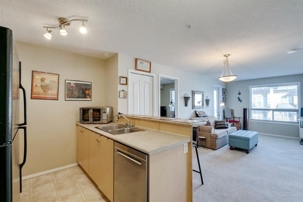 Main Photo: 4320 60 PANATELLA Street NW in Calgary: Panorama Hills Apartment for sale : MLS®# A1075718