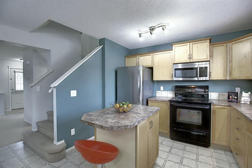 Photo 5: Photos: 646 EVERMEADOW Road SW in Calgary: Evergreen Detached for sale : MLS®# A1023171