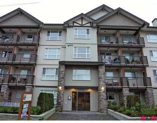 """Photo 1: 105 5465 203RD Street in Langley: Langley City Condo  in """"Station 54"""" : MLS®# F2626460"""