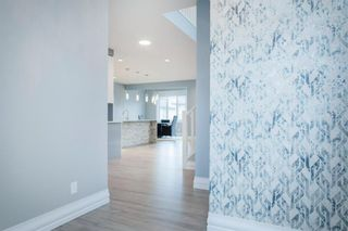 Photo 2: 48 Tremblant Terrace SW in Calgary: Springbank Hill Detached for sale : MLS®# A1131887