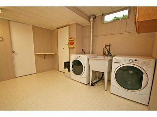 Photo 17: 1151 LAKE WAPTA Road SE in Calgary: Lake Bonavista Residential Detached Single Family for sale : MLS®# C3637144