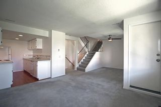 Photo 2: 828 200 Brookpark Drive SW in Calgary: Braeside Row/Townhouse for sale : MLS®# A1153541